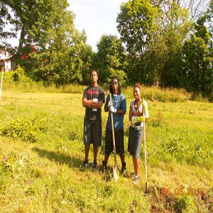 Group members posing with shovels during Summer Program 2012