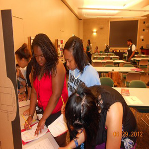 Group members doing paperwork during Summer Program 2012