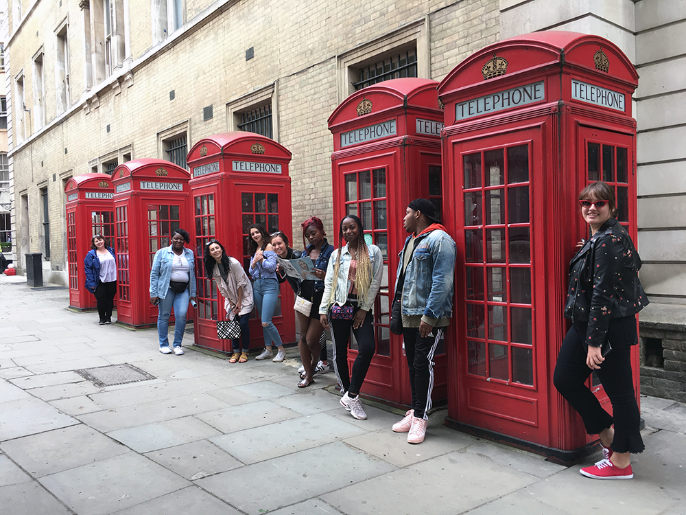 ysu fashion students posing for photo in front of red classic phone booths in london