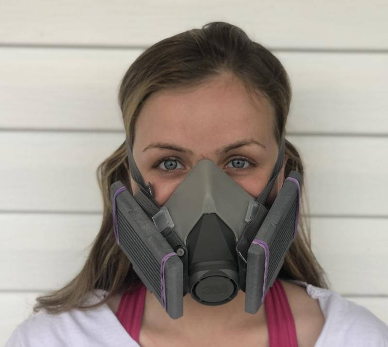 Woman with a commercial facemask equipped with 3D-printed filter cartridges designed by YSU faculty