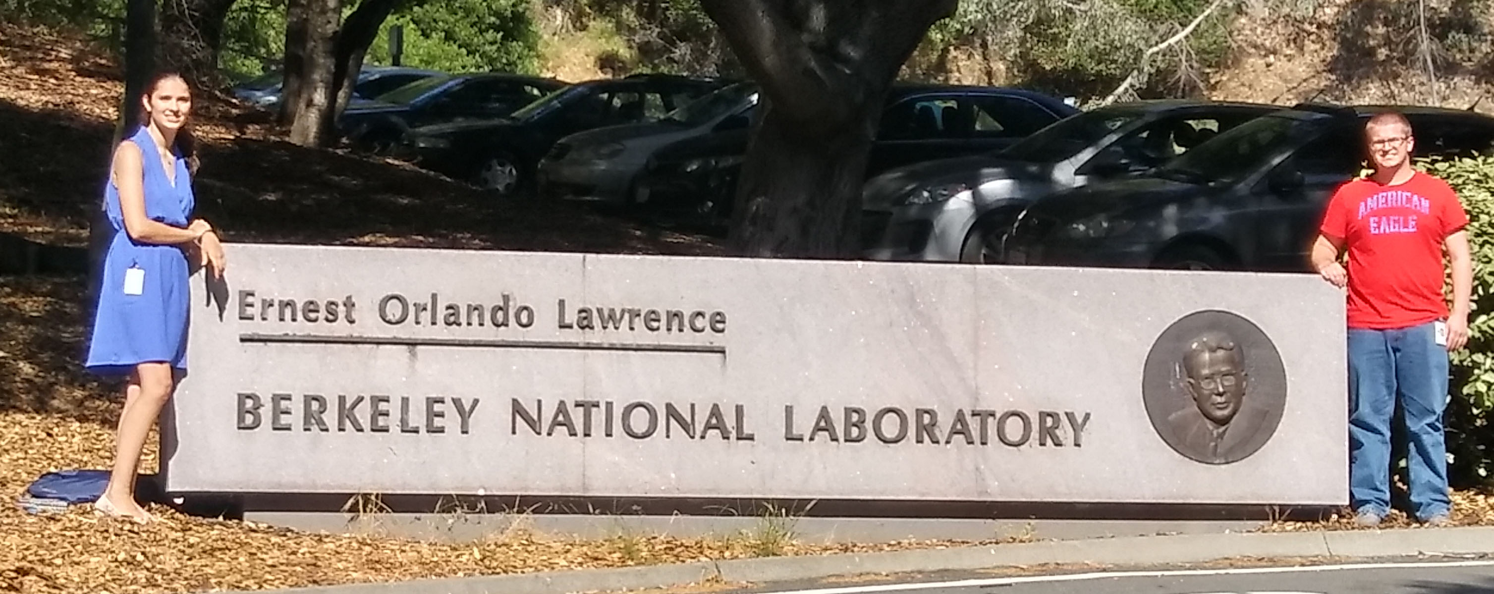 Alexandra Ballow and Tyler Leibengood stand beside the Lawrence Berkeley National Laboratory sign
