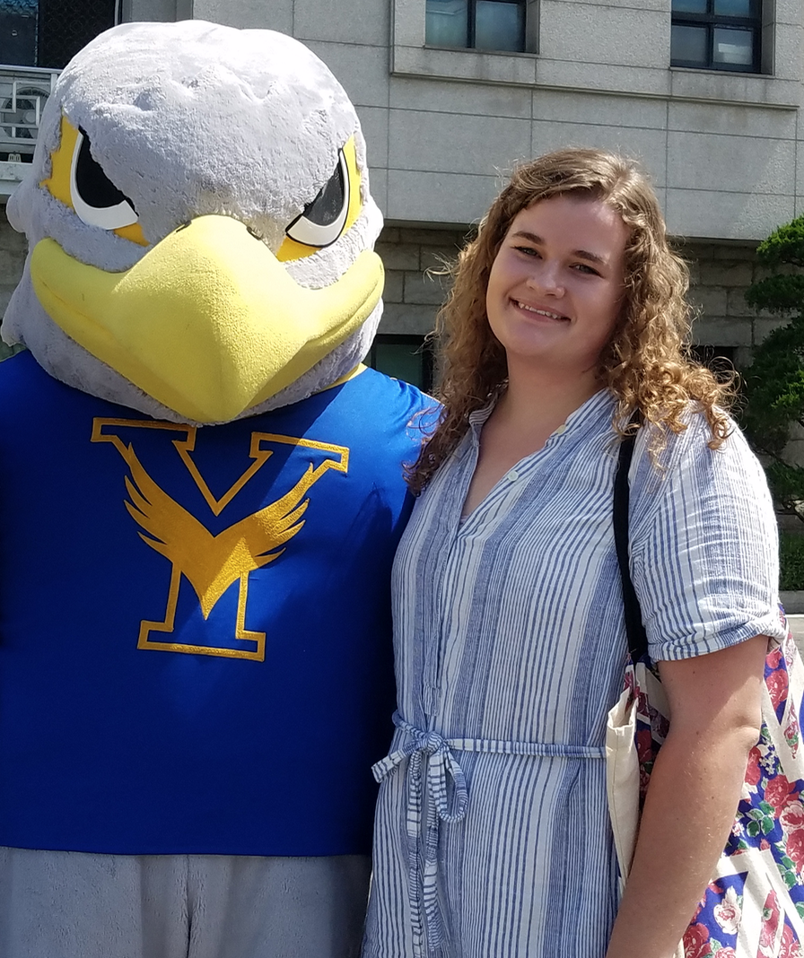 Emily Henline posing with a mascot