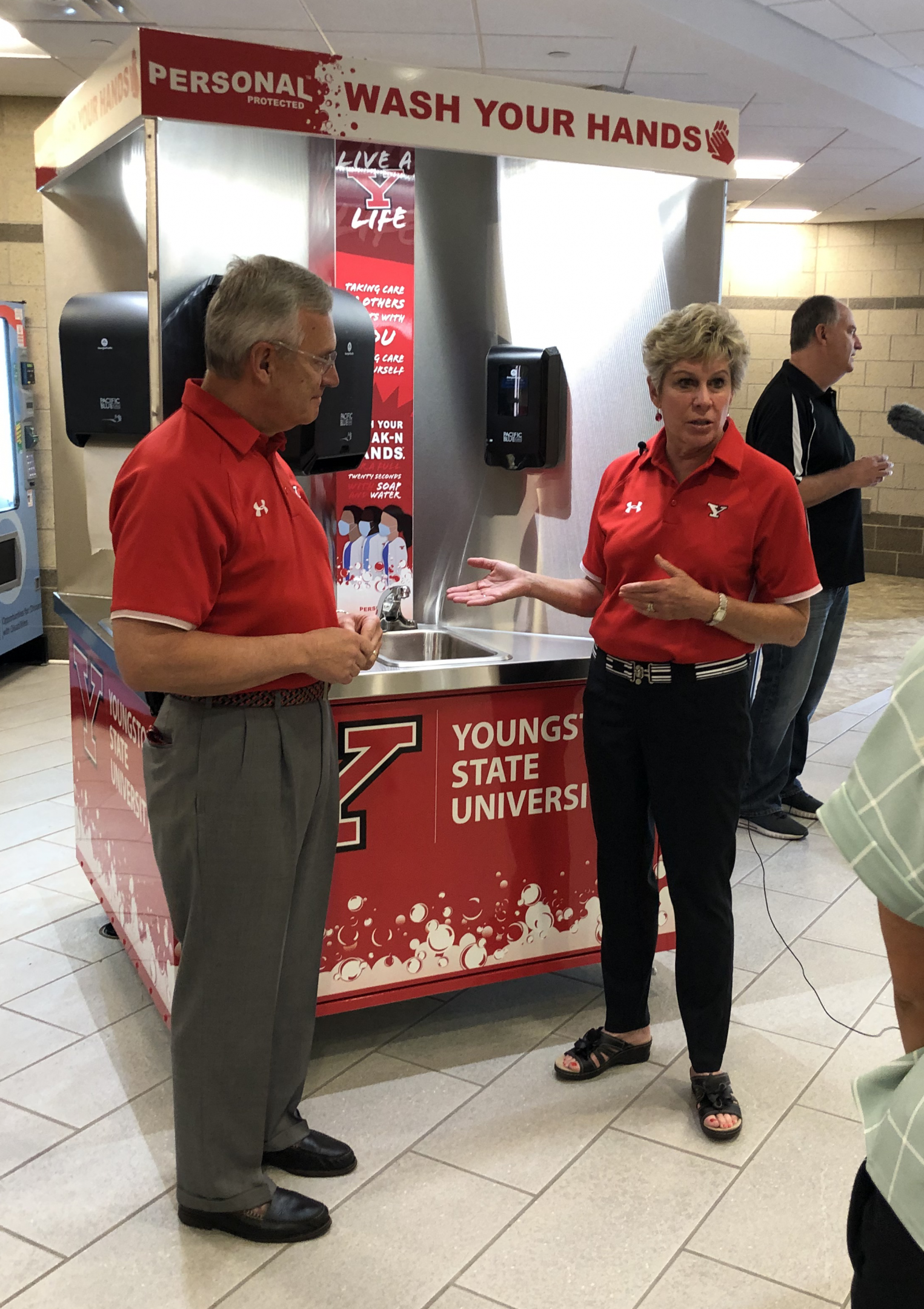 President and Mrs. Ellen Tressel demonstrating the new handwashing stations on campus
