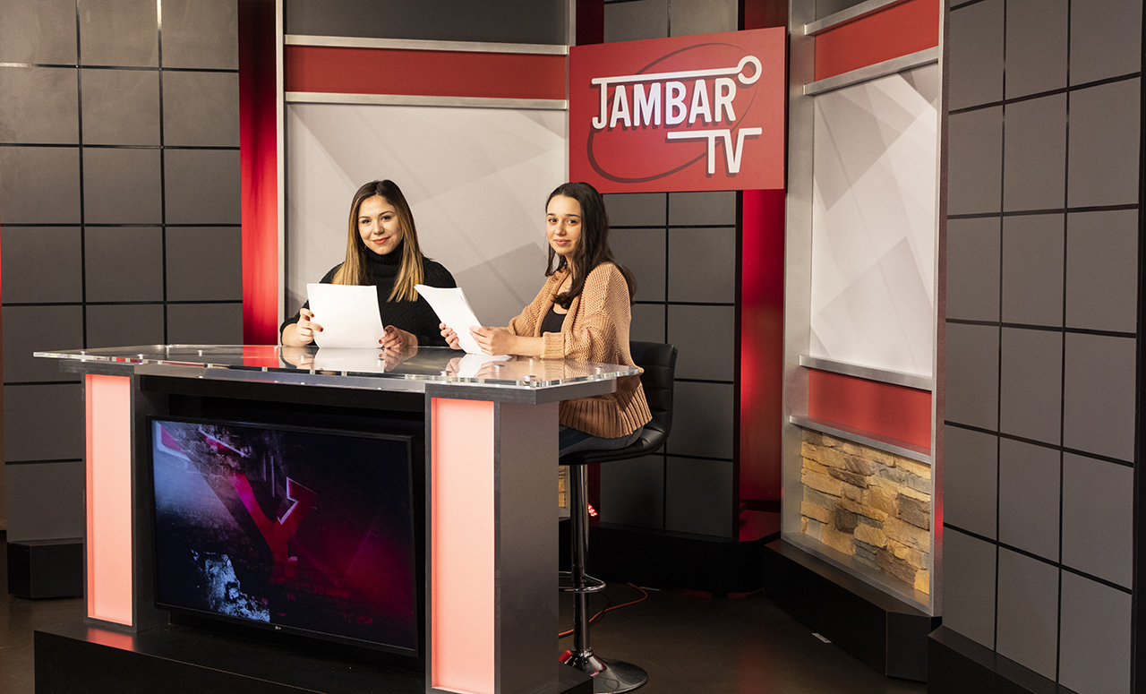 Jambar TV set with two students