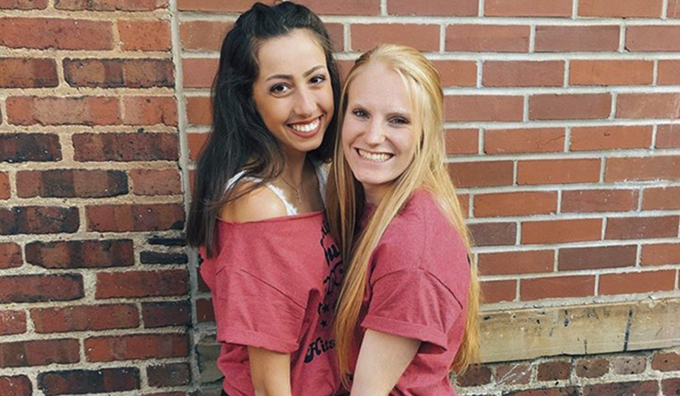 Two sorority sisters posing for photo