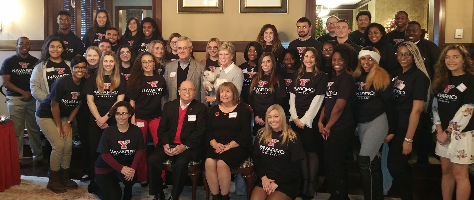 "Flor ""Shorty"" and Elba Navarro, seated front, are pictured with YSU President Jim and Ellen Tressel and a group of the 55 YSU students who are recipients of Navarro scholarships"