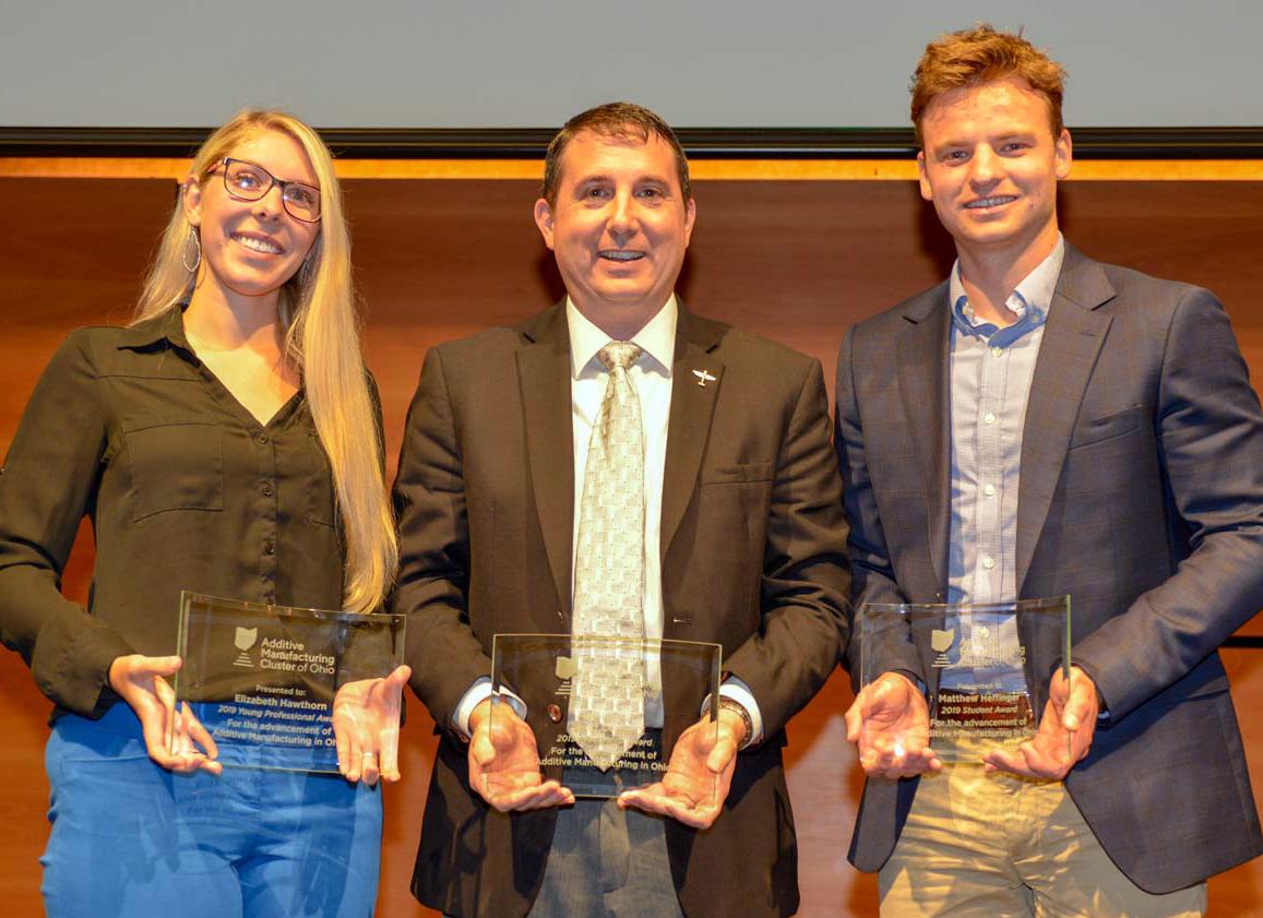 From the left, YSU graduate Emily Hawthorn, faculty member Brett Conner and current student Matthew Heffinger, with their awards from the Ohio Additive Manufacturing Cluster.