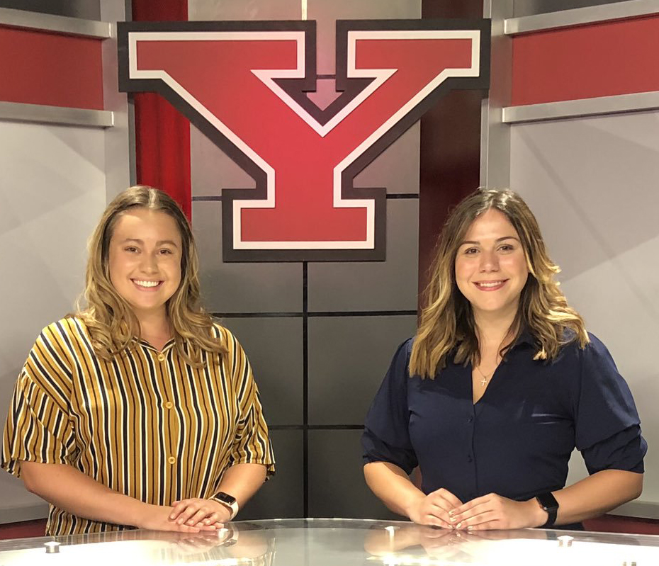 YSU students Amanda Joerndt, left, and Rachel Gobep, members of the news team, pictured on the set of Jambar TV in Bliss Hall.