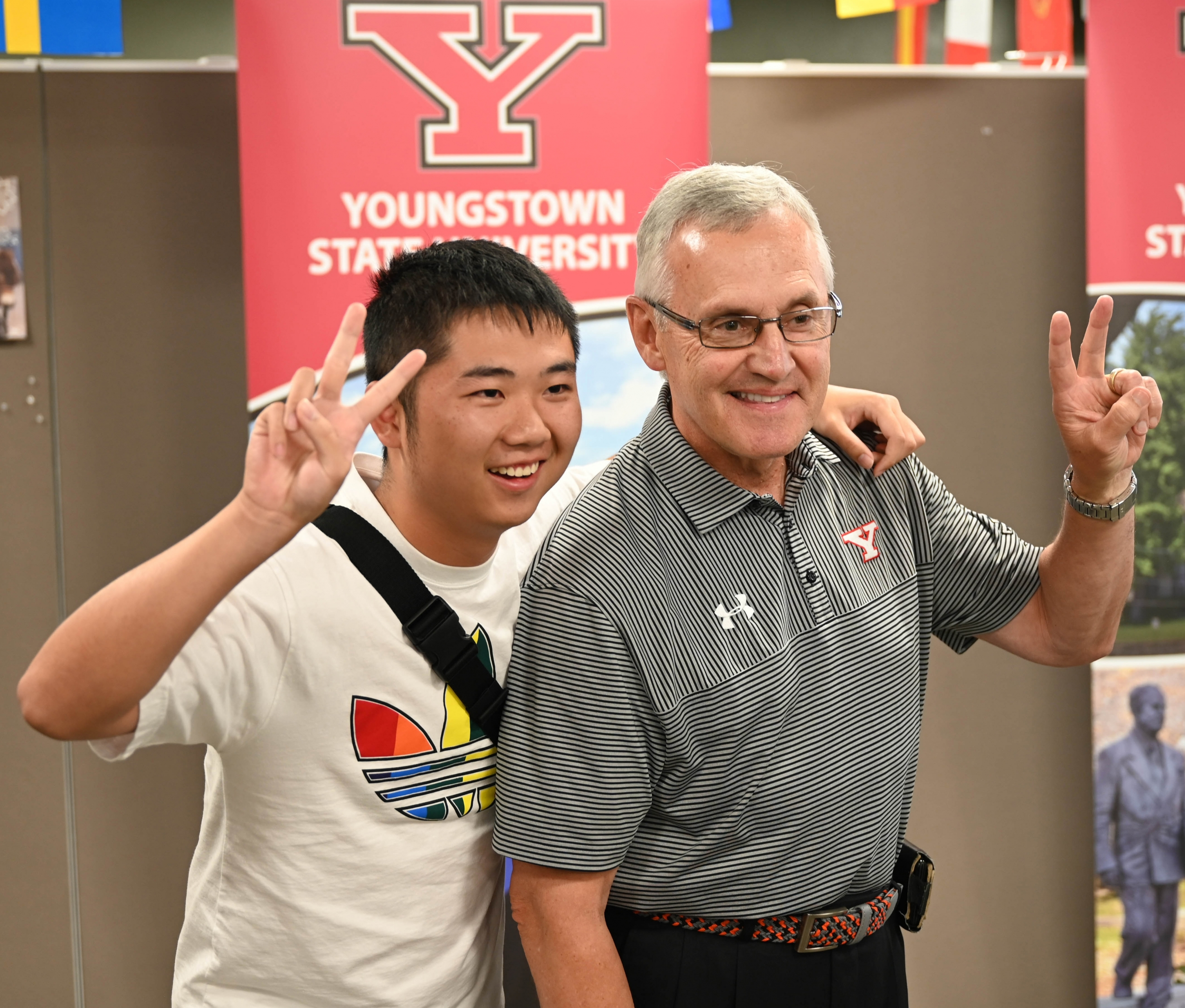 President Jim Tressel and a student in the Summer in America program pose for a photo during the concluding event of the program last week in Jones Hall