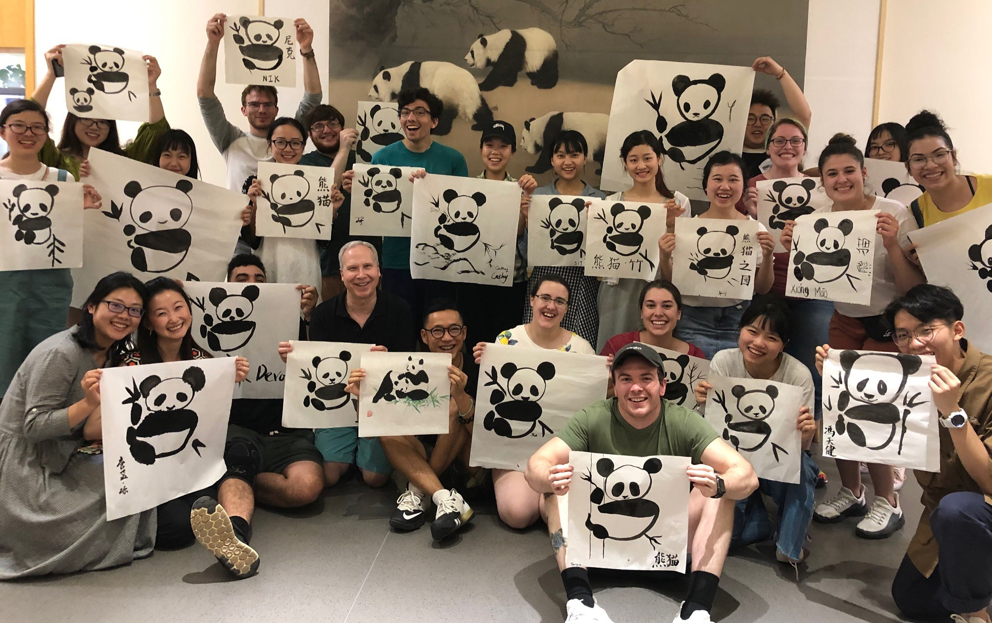 YSU students visiting Chengdu University and painting pandas using the traditional Chinese calligraphy method with students from Sichuan Normal University.