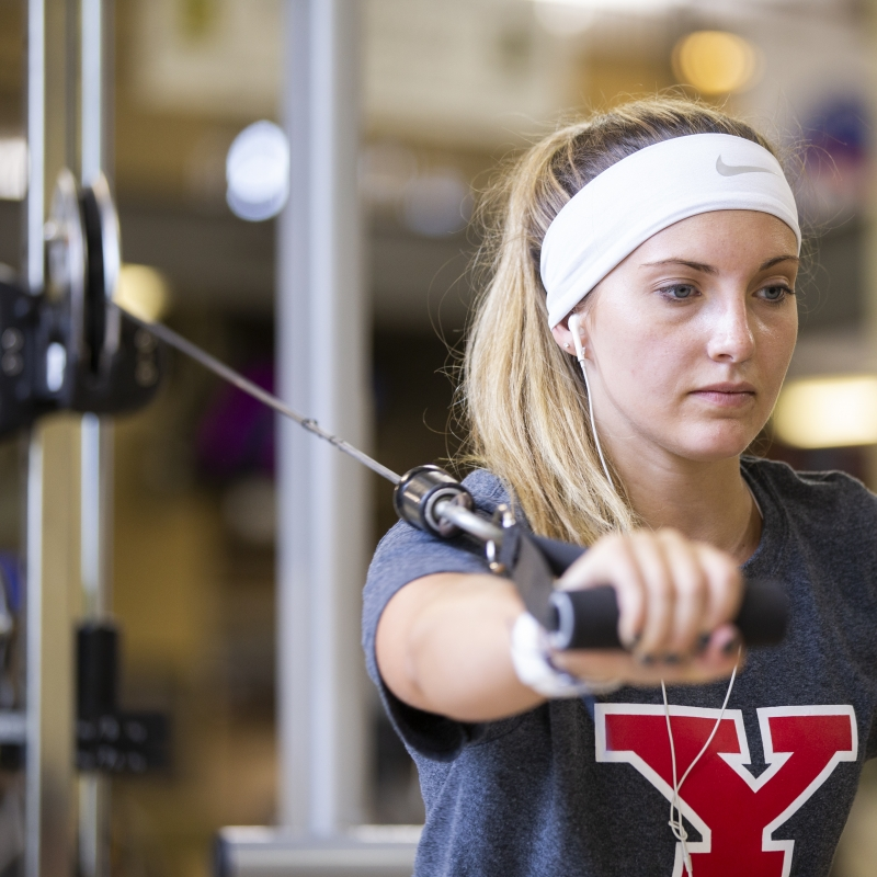 Female student working out in the campus rec center