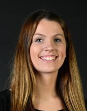 Samantha Johnson in front of YSU Campus Rec Banner