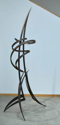 A black metal sculpture designed by Tony Armeni