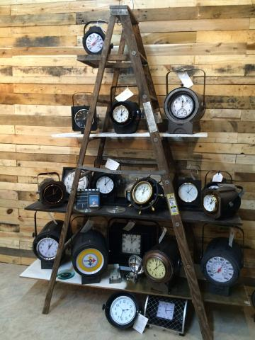A display of clocks on a ladder