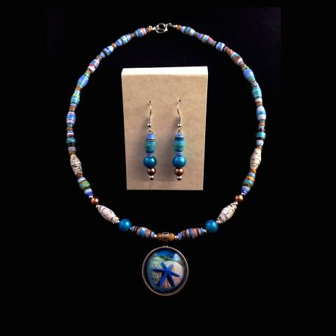Necklace and earring set that is a combination of blues and tans with a starfish on the pendant