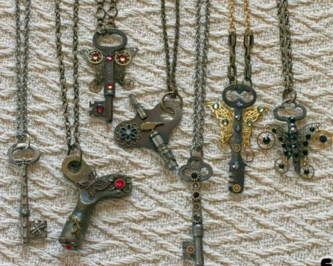 Key necklaces with flowers and butterfly wings designed onto the key