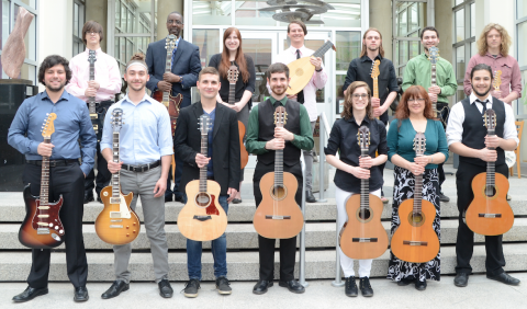 Students in the Dana School of Music Guitar Association posing with their instruments