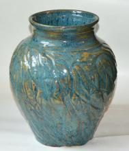 clay pot that is medium in size and is painted blue with gold accents