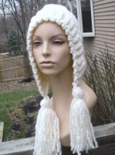A mannequin wearing a white handwoven head scarf