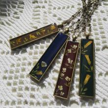 Necklaces with colored pendants with flower designs