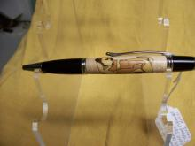 A wooden pen with a dog carved in the side