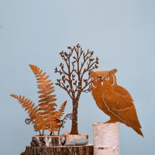 An owl and trees designed from metal