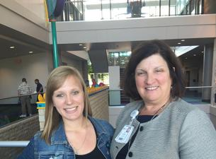 Olivia Millsop, left, with her internship mentor Dr. Elena Rossi, a Youngstown pediatrician