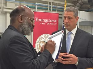 Tim Ryan speaks to a reporter