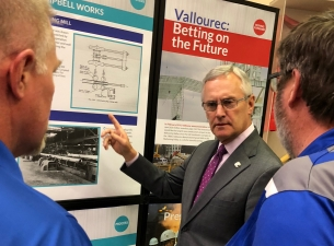 SU President Jim Tressel talks with employees of Vallourec at the new exhibit at the Youngstown Hist