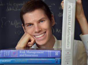 Man posing with mathematics books
