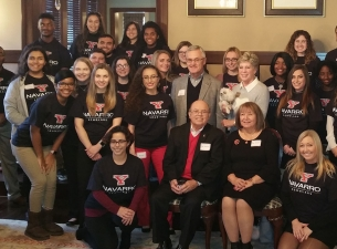 "Flor ""Shorty"" and Elba Navarro, seated front, are pictured with YSU President Jim and Ellen Tressel"