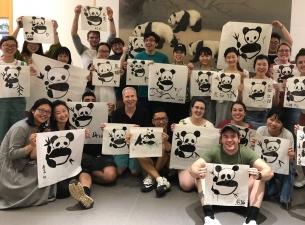 YSU students visiting Chengdu University and painting pandas using the traditional Chinese calligrap