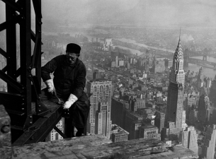 This photo from the National Archives of a worker on the framework of the Empire State Building in N
