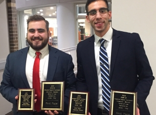 Michael Factor, left, and Moataz Abdelrasoul after winning the Cleveland Marshall Regional Moot Cour