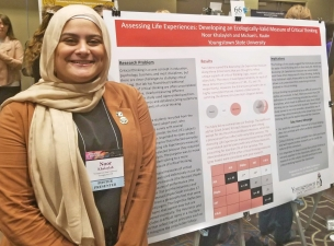 YSU student Noor Khalayleh with her winning research at the National Collegiate Honors Council Confe
