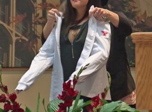 "sophomore Nursing students at Youngstown State University receive ""white coats"" during a ceremony"