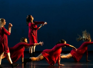 Members of the YSU Dance Ensemble practicing a routine on stage