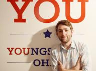 YSU professor RJ Thompson with City of You sign