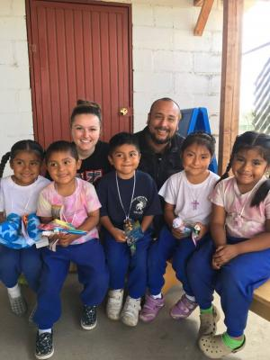 YSU Nursing student Ashley Milligan visits with residents of San Quintin, Mexico, on a previous mission trip.