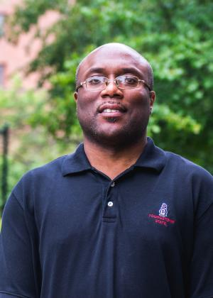 A headshot of Michael Beverly, staff member of Center for Student Progress, posing outside of the office on the campus of Youngstown State University