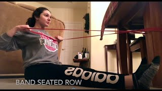 Girl using pulling resistance band