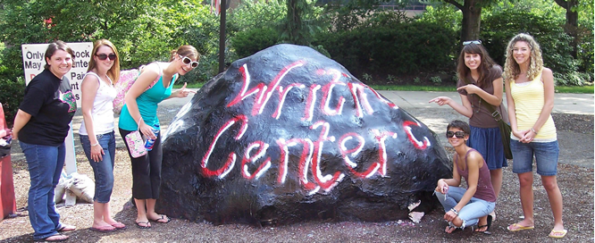 Students painting the rock